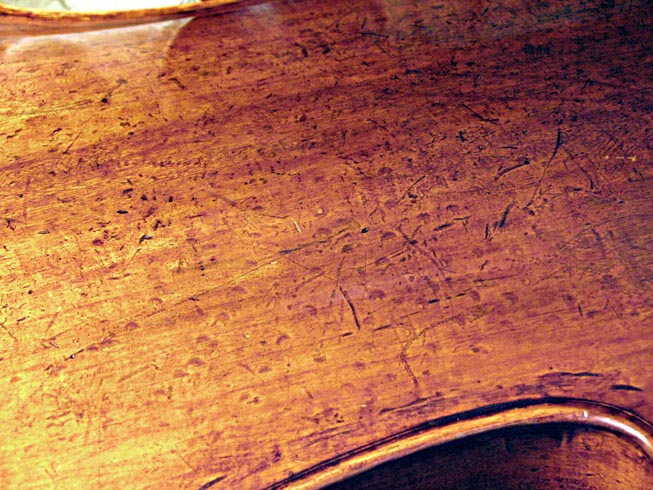 Strad punch marks